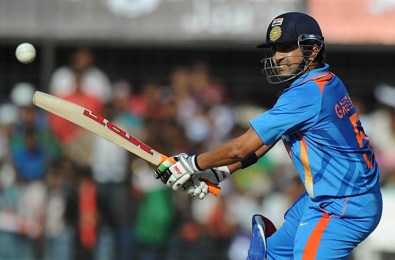 India's batsman Gautam Gambhir plays a shot during the fourth one-day international cricket match between India and West Indies at the Holkar Stadium in Indore on December 8, 2011. India won the toss and elected to bat. AFP PHOTO/Punit PARANJPE (Photo credit should read PUNIT PARANJPE/AFP/Getty Images)