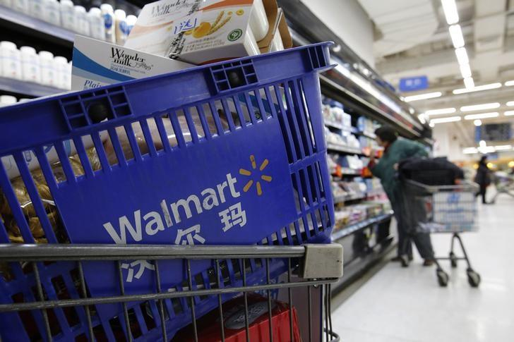 A shopping cart full of products is seen as a customer shops at a Wal-Mart store in Beijing