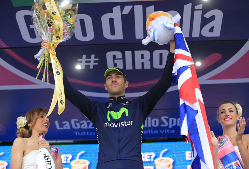 British Alex Dowsett celebrates on the podium winning the 555kms eigth stage of the 96th Giro dItalia time trial from Gabicce Mare to Saltara on May 11 2013 in Saltara ItalyBriton Alex Dowsett took the honours ahead of compatriot Bradley Wiggins in the Tour of Italys eighth stage time trial on Saturday with Italian Vincenzo Nibali inheriting the leaders pink jersey AFP PHOTO LUK BENIES Photo credit should read LUK BENIESAFP via Getty Images
