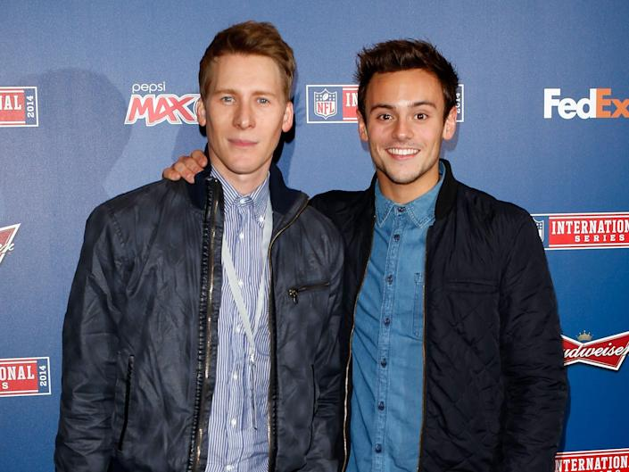 Tom Daley on right and Dustin Lance Black on left early in their relationship on red carpet