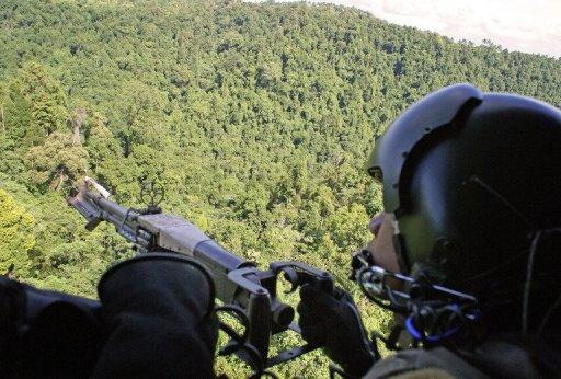A Philippine Air Force gunner, pictured manning a machine gun while flying over an area in restive southern Philippines