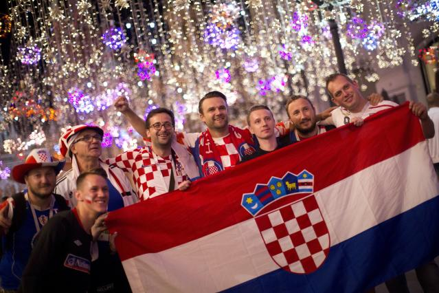 Croatia fans celebrate their team victory after the semifinal soccer match between Croatia and England during the 2018 soccer World Cup in Nikolskaya street near the Kremlin in Moscow, Russia, Thursday, July 12, 2018. (AP Photo/Alexander Zemlianichenko)