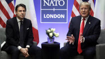 FILE - In this Wednesday, Dec. 4, 2019 file photo, President Donald Trump meets with Italian Prime Minister Giuseppe Conte during the NATO summit at The Grove, in Watford, England. When Giuseppe Conte exited the premier's office, palace employees warmly applauded in him appreciation. But that's hardly likely to be Conte's last hurrah in politics. Just a few hours after the handover-ceremony to transfer power to Mario Draghi, the former European Central Bank chief now tasked with leading Italy in the pandemic, Conte dashed off a thank-you note to citizens that sounded more like an ''arrivederci″ (see you again) then a retreat from the political world he was unexpectedly propelled into in 2018. (AP Photo/ Evan Vucci)