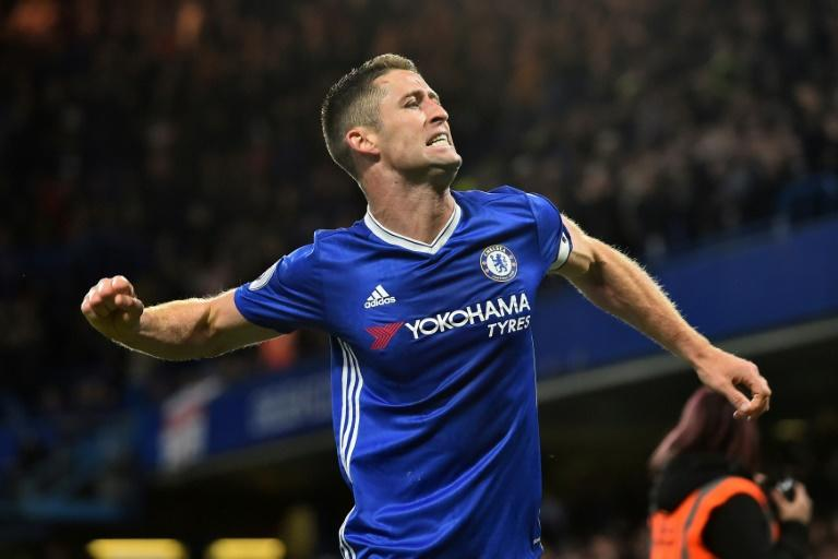 Chelsea's defender Gary Cahill celebrates after scoring their second goal during the English Premier League football match against Southampton April 25, 2017
