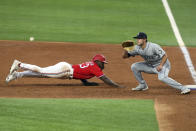Texas Rangers' Adolis Garcia (53) dives back to first as Seattle Mariners first baseman Evan White (12) gets the pickoff throw during the third inning during a baseball game Friday, May 7, 2021, in Arlington, Texas. Garcia was initially called safe but after review was called out. (AP Photo/Richard W. Rodriguez)