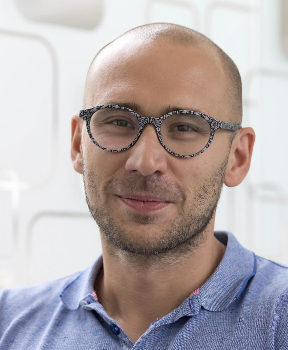 Italian Institute of Technology, IIT, researcher Francesco DiStasio poses for a portrait in this Jan. 1, 2018 photo at the IIT in Genoa, Italy. Backed by 261 billion euros from the EU and Italian government, the country's recovery plan calls for a top-to-bottom shakeup of a major industrial economy long hampered by red tape, a fear of change, and bureaucratic and educational inertia. Leading the charge is Premier Mario Draghi, the former head of the European Central Bank, who was tapped as head of a national unity government specifically for his economic expertise and institutional knowledge both in Italy and the EU.A key target is keeping more young Italians from taking their know-how abroad, a perennial issue in Italy, which has one of the lowest rates of university graduates in Europe and one of the largest brain drains.. (Duilio Farina/IIT via AP)