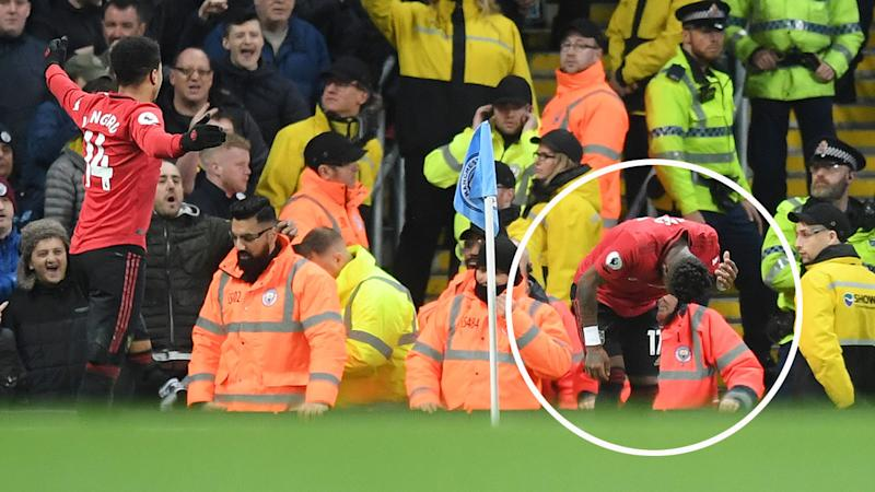 Pictured on the right, United midfielder Fred was struck by a projectile thrown from the crowd.