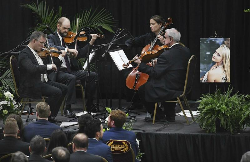 A string quartet plays during a memorial service for Chris Cline and his daughter, Kameron Cline, who were victims of the helicopter accident, Friday, July 12, 2019 at the Beckley Raleigh County Convention Center in Beckley, W.Va. (Rick Barbero/The Register-Herald via AP)