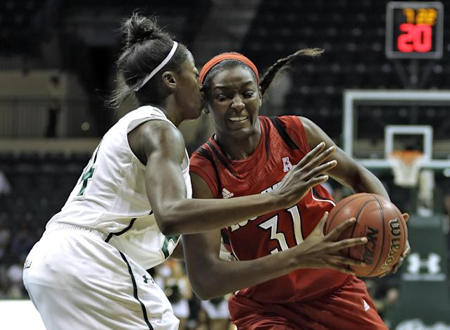 Louisville forward Asia Taylor (31) runs into South Florida forward Alisia Jenkins while going to the basket during the first half of an NCAA college basketball game on Sunday, Jan. 12, 2014, in Tampa, Fla. (AP Photo/Chris O'Meara)