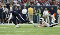 <p>Joey Bosa #99 of the San Diego Chargers loses his helmet as he trips up Brock Osweiler #17 of the Houston Texans in the fourth quarter at NRG Stadium on November 27, 2016 in Houston, Texas. (Photo by Tim Warner/Getty Images) </p>