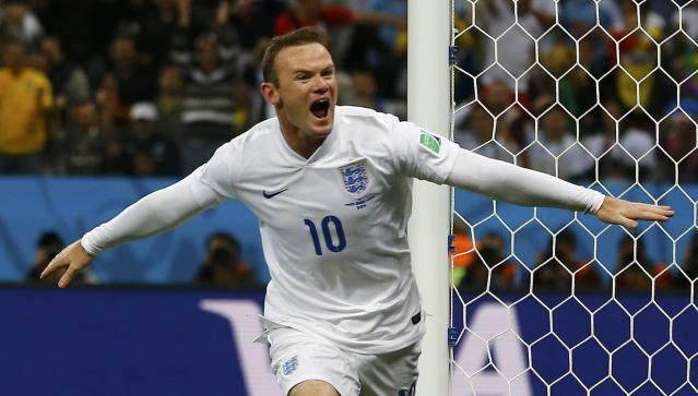 England's Wayne Rooney celebrates scoring against Uruguay during their 2014 World Cup Group D soccer match at the Corinthians arena in Sao Paulo June 19, 2014. REUTERS/Damir Sagolj (BRAZIL - Tags: SOCCER SPORT WORLD CUP) TOPCUP