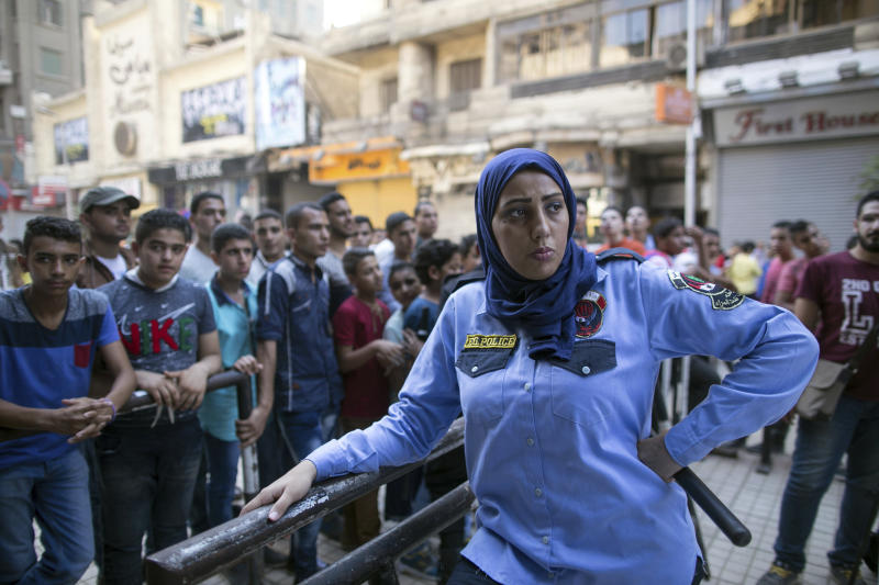 FILE - In this July 17, 2015 file photo, an Egyptian policewoman from a newly formed force to combat sexual harassment in the streets is deployed in Cairo on the first day of Eid Al-Fitr. A video posted on Facebook Aug. 15, 2018, by an Egyptian woman who says a man stalked her at a bus stop has stirred online debate, with many -- including women -- taking the man's side. Some say he was politely flirting and the woman overreacted, while others have speculated about what she was wearing, suggesting she was the one at fault. The diverging responses point to the difficulty in combatting the rampant sexual harassment on Egypt's streets. (AP Photo/Roger Anis, File)