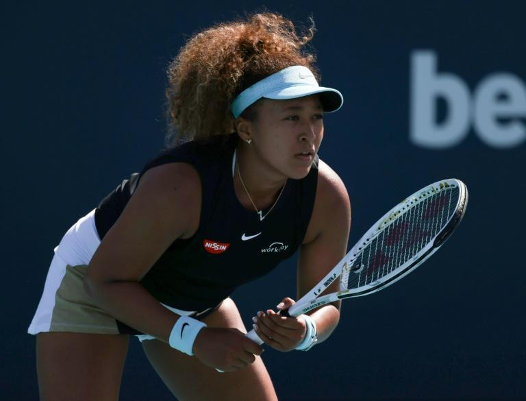 Japan's second-seeded Naomi Osaka advanced to the WTA Miami Open quarter-finals by defeating Elise Mertens of Belgium on Monday