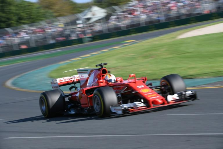 Ferrari's German driver Sebastian Vettel powers through a curve during the Formula One Australian Grand Prix in Melbourne