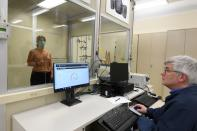 FILE PHOTO: Workers test an N95 mask at a laboratory of 3M in Maplewood, Minnesota