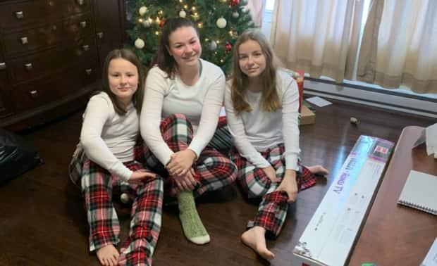 Lexi, right, with her sisters, Brennah, left, and Piper.