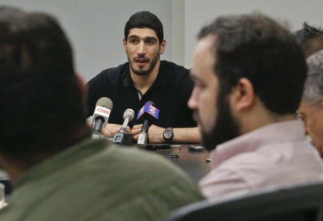 "<a class=""link rapid-noclick-resp"" href=""/nba/players/4899/"" data-ylk=""slk:Enes Kanter"">Enes Kanter</a> speaks about being detained at an airport in Bucharest, Romania, during a press conference in May. (AP)"