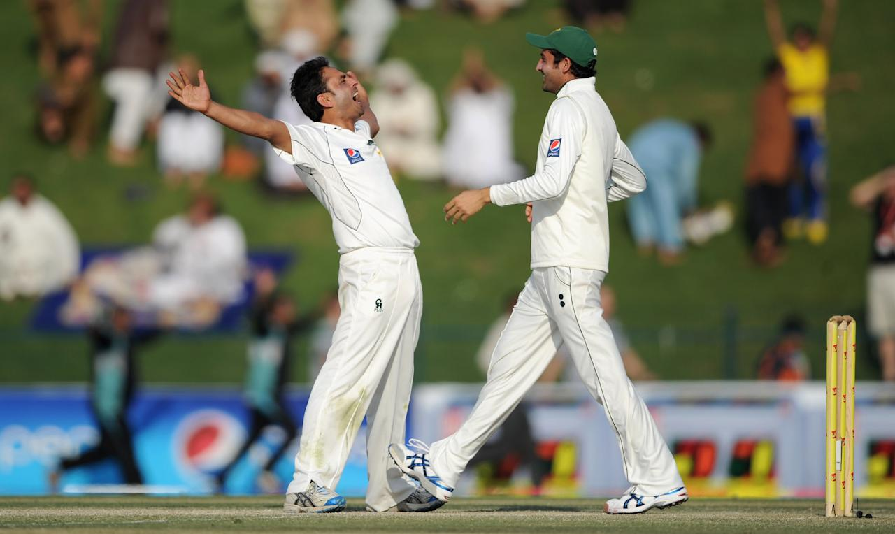ABU DHABI, UNITED ARAB EMIRATES - JANUARY 28:  Abdur Rehman of Pakistan celebrates with Junaid Khan after dismissing James Anderson of England to win the second Test match between Pakistan and England at Sheikh Zayed Stadium on January 28, 2012 in Abu Dhabi, United Arab Emirates.  (Photo by Gareth Copley/Getty Images)