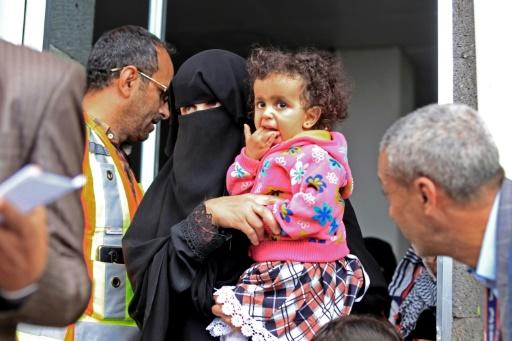 A sick Yemeni child is carried onto a UN plane at Sanaa airport for evacuation to Amman for urgent medical treatment