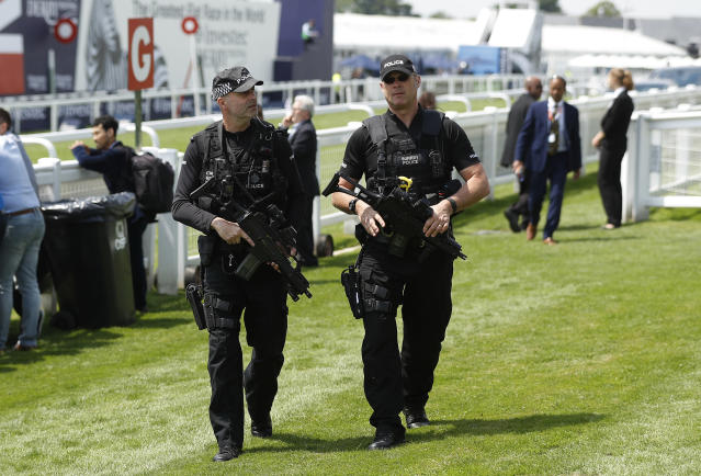 Britain Horse Racing - Derby Festival - Epsom Racecourse - June 2, 2017 Armed Police officers during the Derby Festival Reuters / Peter Nicholls Livepic EDITORIAL USE ONLY.
