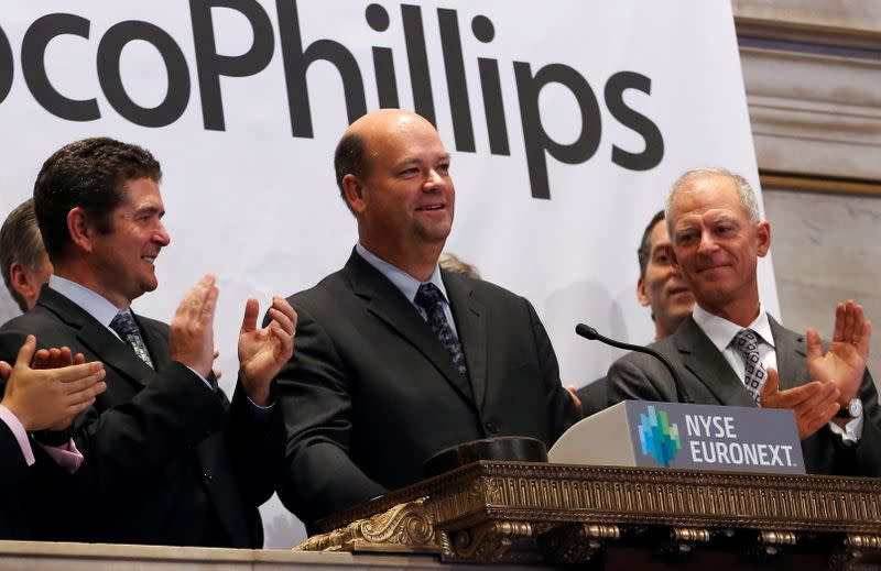 FILE PHOTO: ConocoPhillips Chairman and CEO Lance rings the closing bell at the New York Stock Exchange