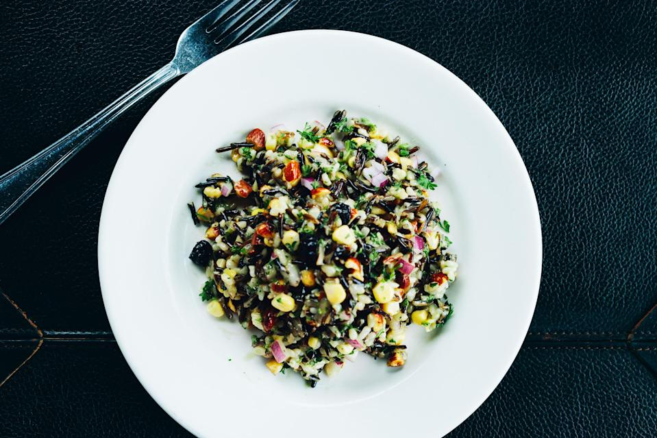 """A tangy and nutty rice salad to serve with broiled fish, pan-roasted pork chops, or roast turkey. <a href=""""https://www.bonappetit.com/recipe/wild-rice-salad-with-corn-blueberries-and-almonds?mbid=synd_yahoo_rss"""" rel=""""nofollow noopener"""" target=""""_blank"""" data-ylk=""""slk:See recipe."""" class=""""link rapid-noclick-resp"""">See recipe.</a>"""