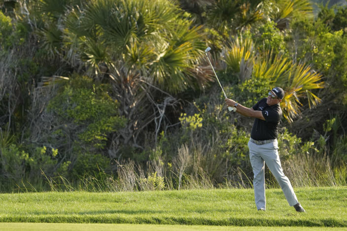 Phil Mickelson watches his second shot on the 10th hole during the second round of the PGA Championship golf tournament on the Ocean Course Friday, May 21, 2021, in Kiawah Island, S.C. (AP Photo/David J. Phillip)