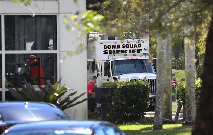 <p>The Broward Sheriff's Office bomb squad investigates a suspicious package at the office of Rep. Debbie Wasserman Schultz (D-FL) on Oct.24, 2018 in Sunrise, Fla. (Photo: Joe Raedle/Getty Images) </p>