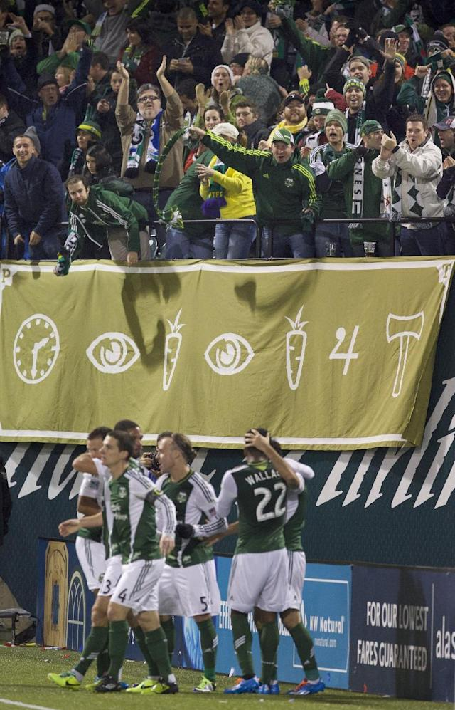 Portland Timbers fans react to a goal by midfielder Diego Valeri (8) against rival Seattle Sounders in Game 2 of the Western Conference semifinals of the MLS Cup at Jeld-Wen Field in Portland Thursday Nov. 7, 2013. (AP Photo/The Oregonian, Randy L. Rasmussen)