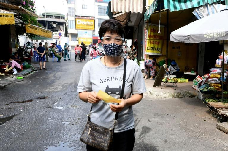 In Hanoi, even trips to food markets are restricted