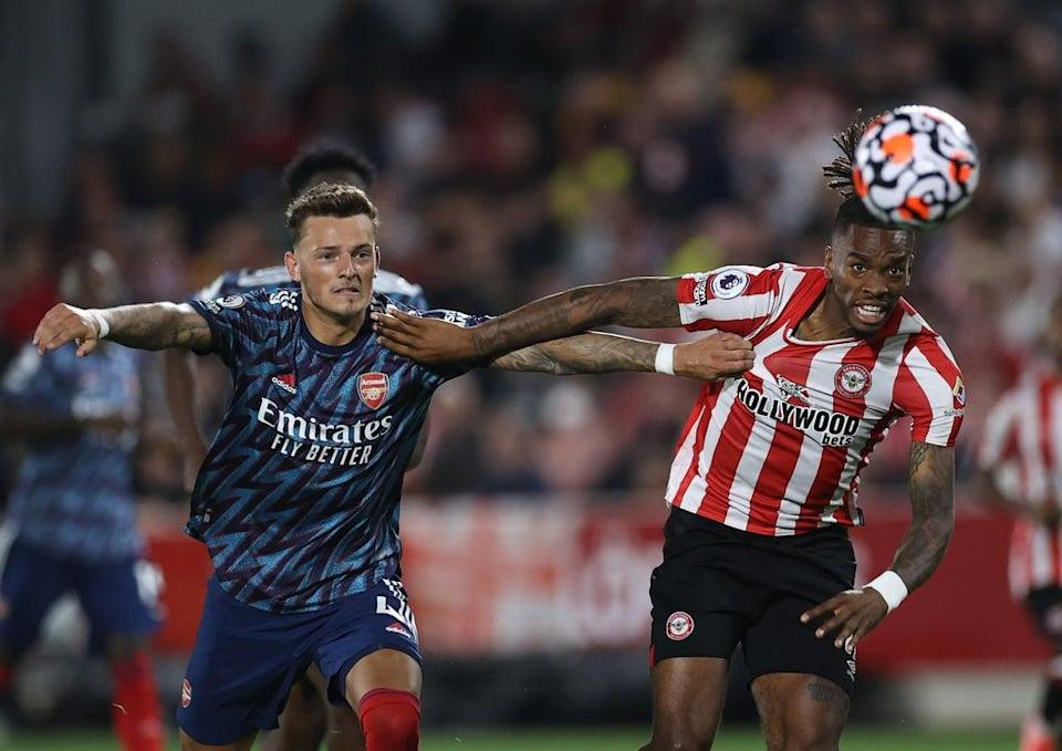 Ben White with Ivan Toney in Arsenal's opening-night defeat by Brentford (Getty Images)