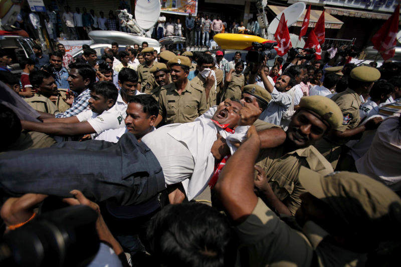Indian policemen detain activists of left parties during a nationwide strike in Hyderabad, India, Thursday, Sept. 20, 2012. Angry opposition supporters disrupted trains in India on Thursday but had only limited success in enforcing a national strike to protest a government decision to cut fuel subsidies and open the country's huge retail market to foreign companies. (AP Photo/Mahesh Kumar A.)