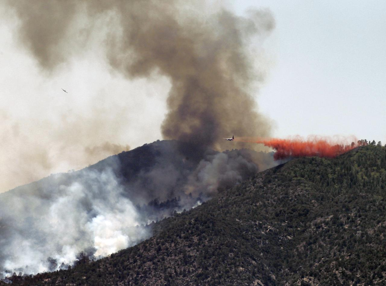 An air tanker drops retardent on a fire Monday, May 14, 2012, near Crown King, Ariz. Fire crews spent the weekend fighting several wildfires including the four and a half square mile blaze near Crown King. (AP Photo/Matt York)