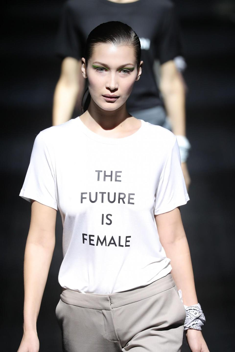 <p>Bella Hadid walks in the Prabal Gurung show in New York, wearing one of a handful of feminism- and equality-stamped T-shirts that the designer featured. (Photo: Getty Images) </p>