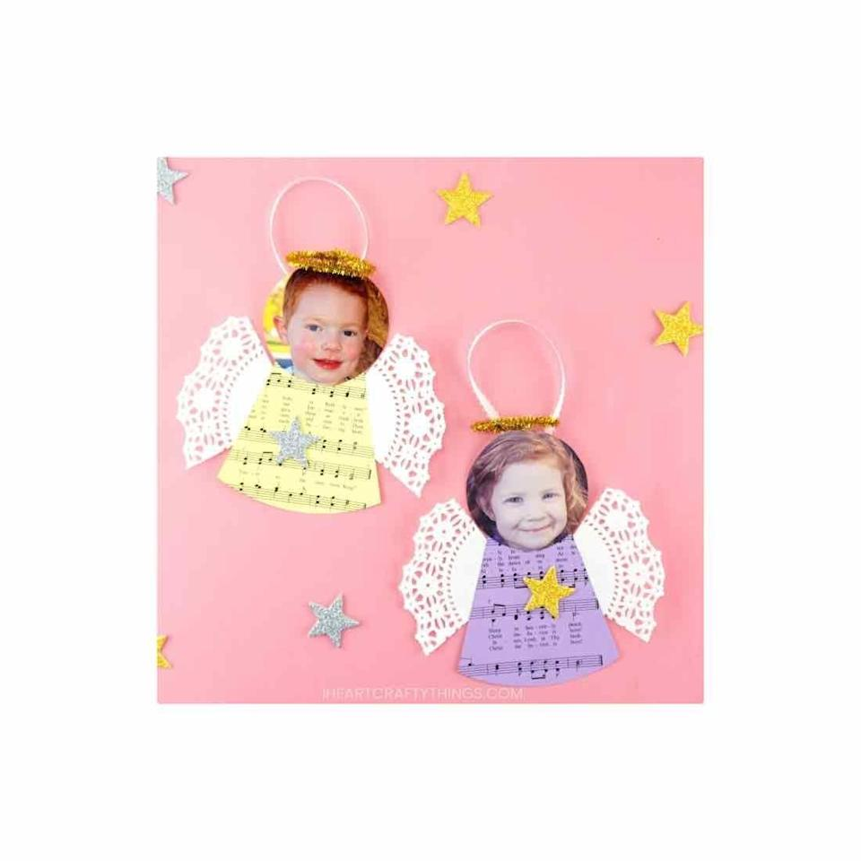 """<p>Put your little angel's face on the top of this paper craft to create a treasured keepsake. </p><p><em>Get the tutorial at <a href=""""https://iheartcraftythings.com/diy-angel-ornaments.html"""" rel=""""nofollow noopener"""" target=""""_blank"""" data-ylk=""""slk:I Heart Crafty Things"""" class=""""link rapid-noclick-resp"""">I Heart Crafty Things</a>.</em></p><p><a class=""""link rapid-noclick-resp"""" href=""""https://www.amazon.com/HAKSEN-Paper-Lace-Doilies-Combo/dp/B01DXQWU3C?tag=syn-yahoo-20&ascsubtag=%5Bartid%7C10072.g.34443405%5Bsrc%7Cyahoo-us"""" rel=""""nofollow noopener"""" target=""""_blank"""" data-ylk=""""slk:SHOP DOILIES"""">SHOP DOILIES</a></p>"""