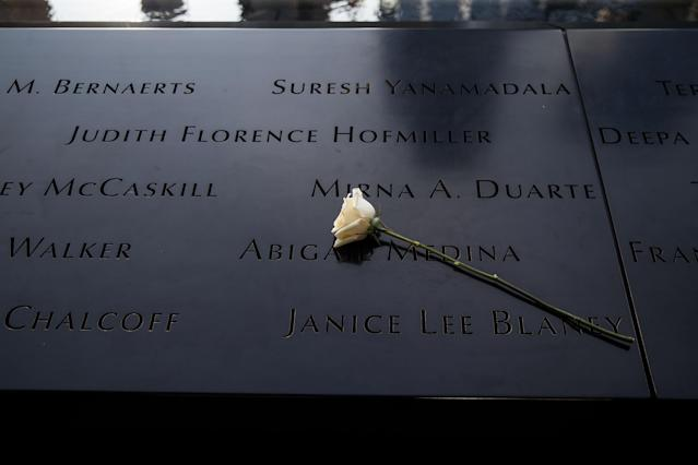 <p>Flowers were left at the North pool memorial site before a commemoration ceremony for the victims of the Sept. 11 terrorist attacks at the National September 11 Memorial, Sept. 11, 2017, in New York City. In New York City and throughout the United States, the country is marking the 16th anniversary of the Sept. 11 terrorist attacks. (Photo: Drew Angerer/Getty Images) </p>