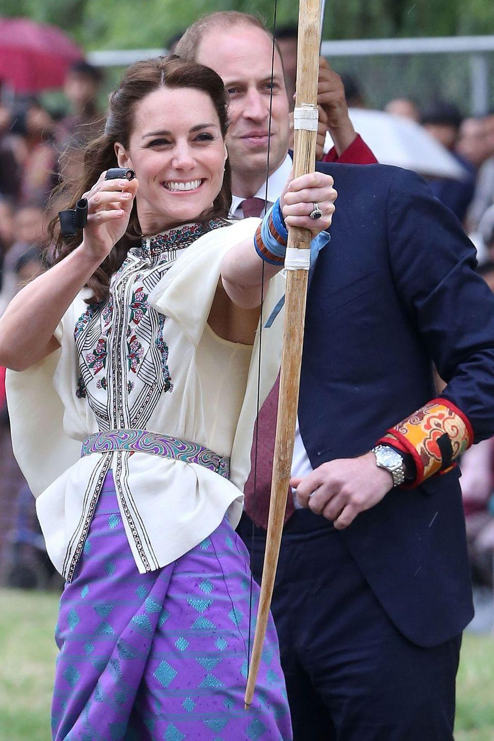 "<p>Go Kate go! The Duchess takes a shot at archery in Thimphu, <a href=""https://www.harpersbazaar.com/celebrity/latest/g7102/kate-middleton-india-bhutan-royal-visit/"" rel=""nofollow noopener"" target=""_blank"" data-ylk=""slk:Bhutan"" class=""link rapid-noclick-resp"">Bhutan</a>. </p>"