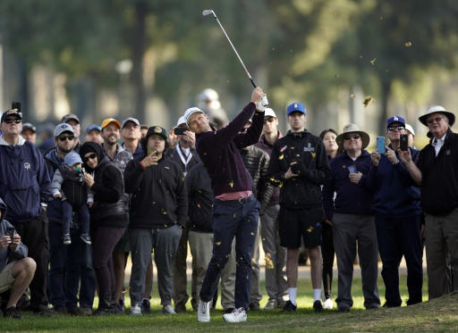 Justin Rose, of England, hits his second shot from the rough on the 13th hole during the second round of the Genesis Invitational golf tournament at Riviera Country Club, Friday, Feb. 14, 2020, in the Pacific Palisades area of Los Angeles. (AP Photo/Ryan Kang)