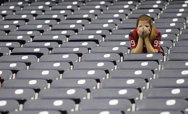 A Houston Texans' fan reacts in the stands after an NFL football game against the St. Louis Rams Sunday, Oct. 13, 2013, in Houston, Texas. The Rams defeated the Texans 38-13. (AP Photo/Patric Schneider)