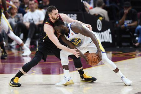 Jun 8, 2018; Cleveland, OH, USA; Cleveland Cavaliers center Kevin Love (0) pressures Golden State Warriors forward Draymond Green (23) during the third quarter in game four of the 2018 NBA Finals at Quicken Loans Arena. Mandatory Credit: Ken Blaze-USA TODAY Sports