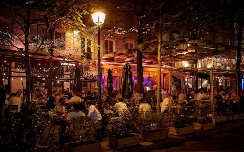Parisians embrace the weekend in a packed bar - Kiran Ridley/Getty Images