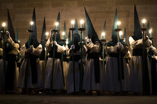 <p>Penitents from Las Siete Palabras brotherhood take part in a procession in Zamora, Spain, April 16, 2014. Hundreds of processions take place throughout Spain during the Easter Holy Week. (AP Photo/Andres Kudacki) </p>