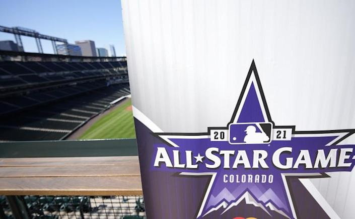 A sign bearing the 2021 MLB All-Star Game logo stands in the upper deck at Coors Field.