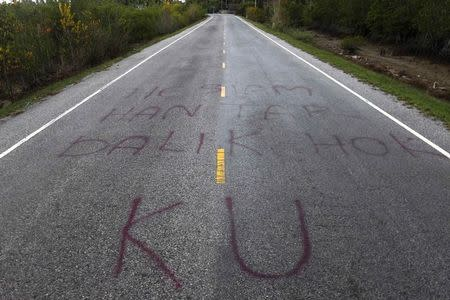 Separatist graffiti is seen on a road near Pattani, one of three southernmost provinces of Thailand where government troops have fought Muslim insurgents since 2004