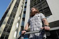 Blast survivor Shady Rizk at the building hosting his former office, overlooking Beirut port