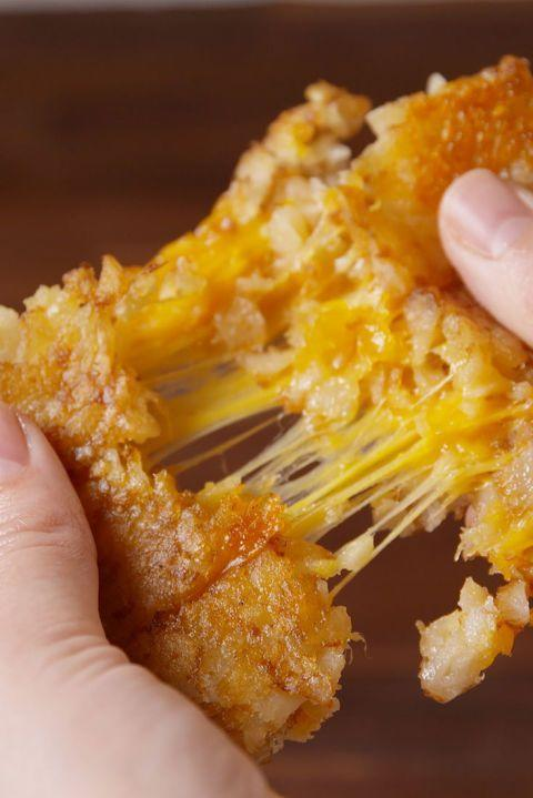 """<p>Replace bread with tater tots for some next-level grilled cheese.</p><p><strong>Get the recipe at <a href=""""http://www.delish.com/cooking/recipe-ideas/recipes/a51214/tater-tot-grilled-cheese-recipe/"""" rel=""""nofollow noopener"""" target=""""_blank"""" data-ylk=""""slk:Delish"""" class=""""link rapid-noclick-resp"""">Delish</a>.</strong><br></p>"""