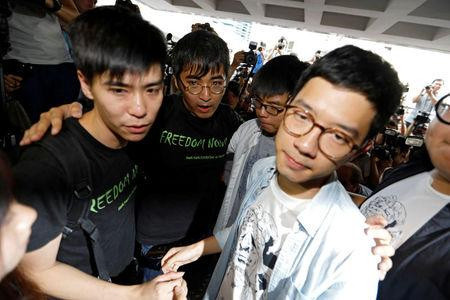Hong Kong's Umbrella Movement leaders jailed for participating in pro-democracy protests