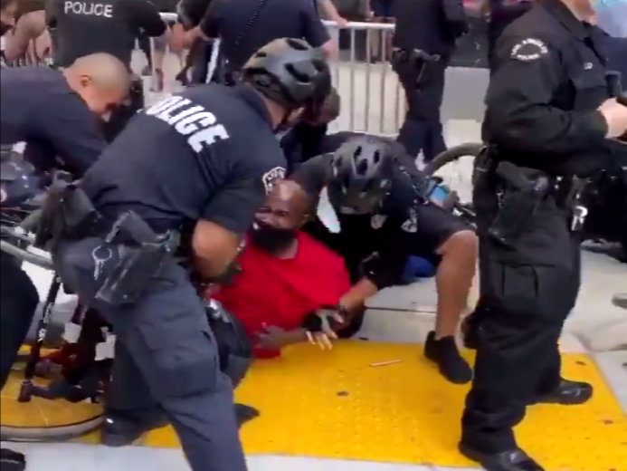 The police detain a man in a wheelchair at a Black Lives Matter protest in California: (@allykerans - Twitter)
