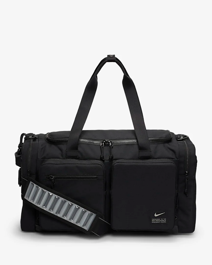 """<h3>Nike Utility Power Duffel Bag <br></h3><br>This utility-inspired duffle bag features multiple side pockets for your easy-to-lose travel bit and bobs. It was also designed with durability in mind to keep your personal items safe and any gear you're traveling with secure. <br><br><em>Shop <strong><a href=""""https://www.nike.com"""" rel=""""nofollow noopener"""" target=""""_blank"""" data-ylk=""""slk:Nike"""" class=""""link rapid-noclick-resp"""">Nike</a></strong></em><br><br><strong>Nike</strong> Utility Power Duffle, $, available at <a href=""""https://go.skimresources.com/?id=30283X879131&url=https%3A%2F%2Fwww.nike.com%2Ft%2Futility-power-training-duffel-bag-medium-cWmT7h%2FCK2792-010"""" rel=""""nofollow noopener"""" target=""""_blank"""" data-ylk=""""slk:Nike"""" class=""""link rapid-noclick-resp"""">Nike</a>"""