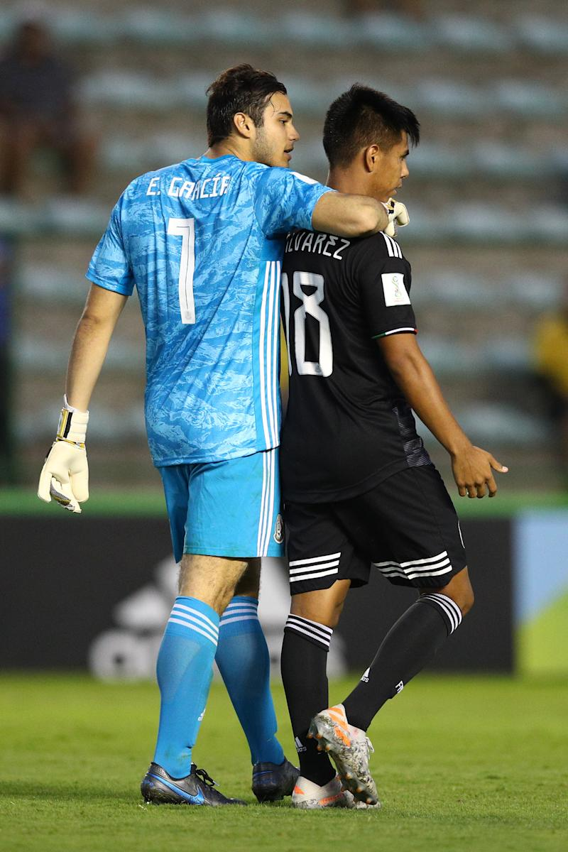 BRASILIA, BRAZIL - NOVEMBER 14: Eduardo Garcia of Mexico celebrates with his team-mate Efrain Alvarez during a penalty shootout during the FIFA U-17 World Cup Brazil 2019 semi-final match between Mexico and the Netherlands at Estadio Bezerrao on November 14, 2019 in Brasilia, Brazil. (Photo by Buda Mendes - FIFA/FIFA via Getty Images)
